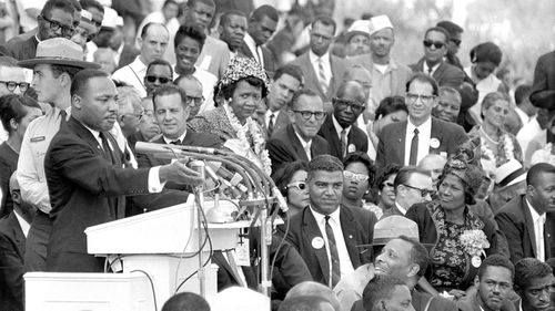 "The Reverend Dr Martin Luther King Jr, head of the Southern Christian Leadership Conference, gestures during his ""I Have a Dream"" speech in August 1963. (AAP)"