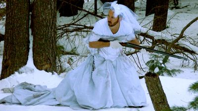A camouflage hunting outfit in the snow. (MyExWifesWeddingDress.com)