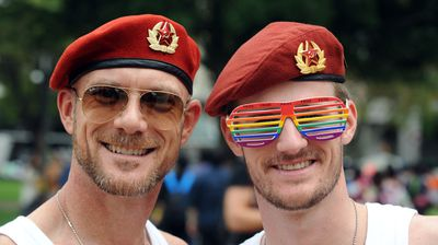 Gents, wearing Russian red berets, prepare for the parade (AAP)