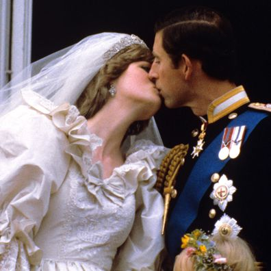 Diana Spencer and Prince Charles, Prince and Princess of Wales kiss on the balcony of Buckingham Palace after their wedding in July 1981