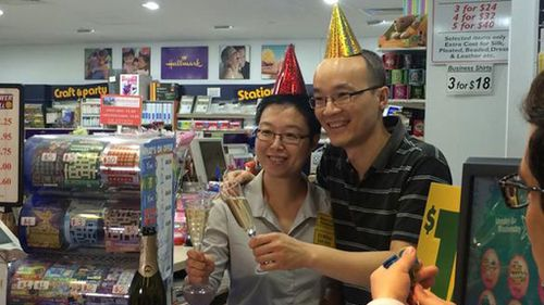 Staff at the newsagency celebrate the win. (Harvey Biggs, 9NEWS)