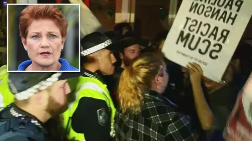 Protesters chanted anti-racism slogans outside Pauline Hanson's Senate launch. (9NEWS)