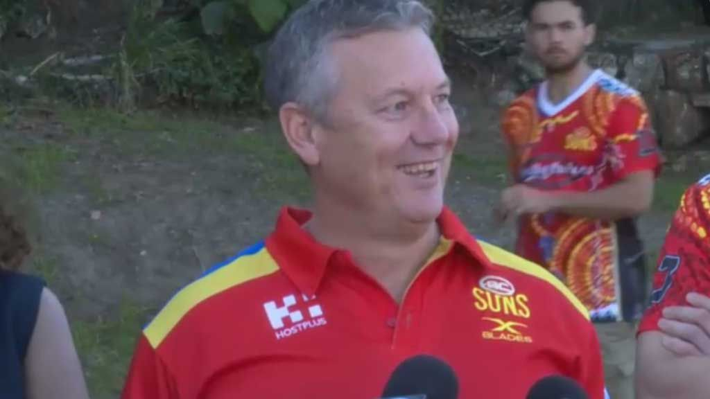 Gold Coast boss hits out, literally, at a reporter