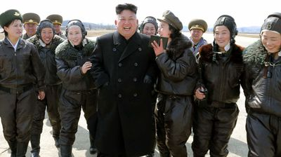 Kim Jong-Un with fly-girl fans (Getty).