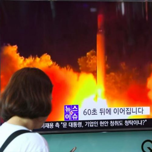 Passers-by on edge in Japan watch television coverage after North Korea launched a missile over the country.