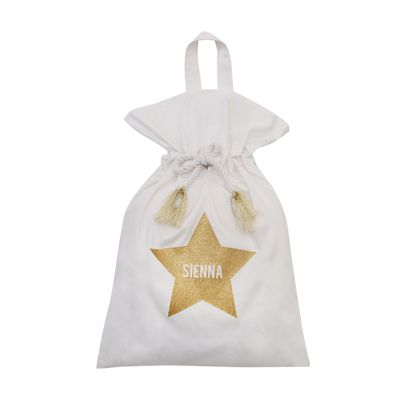 "<a href=""https://www.templeandwebster.com.au/Lux-Collection-Gold-Glitter-Star-Santa-Sack-IDx002SSL-IDTE1004.html"" target=""_blank"">Lux Collection Gold Glitter Star Santa Sack, $59.95.</a>"