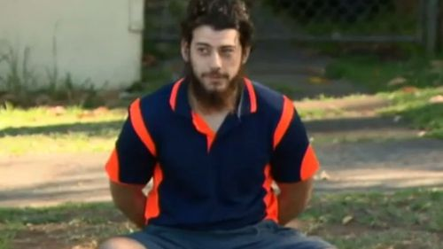 "Mehmet Biber said he only posed with a rifle in Syria because he thought it ""looked cool"". (9NEWS)"