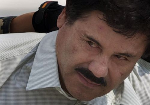 """In this Feb. 22, 2014 file photo, Joaquin """"El Chapo"""" Guzman is escorted to a helicopter in handcuffs by Mexican navy marines at a navy hanger in Mexico City. The notorious Mexican drug lord will have an anonymous jury at his U.S. trial in 2018. In a written order, U.S. District Judge Brian Cogan agreed with prosecutors who argued that withholding the names of jurors was needed to address any fears that they could be harassed or intimidated.(AP Photo/Eduardo Verdugo, File)"""