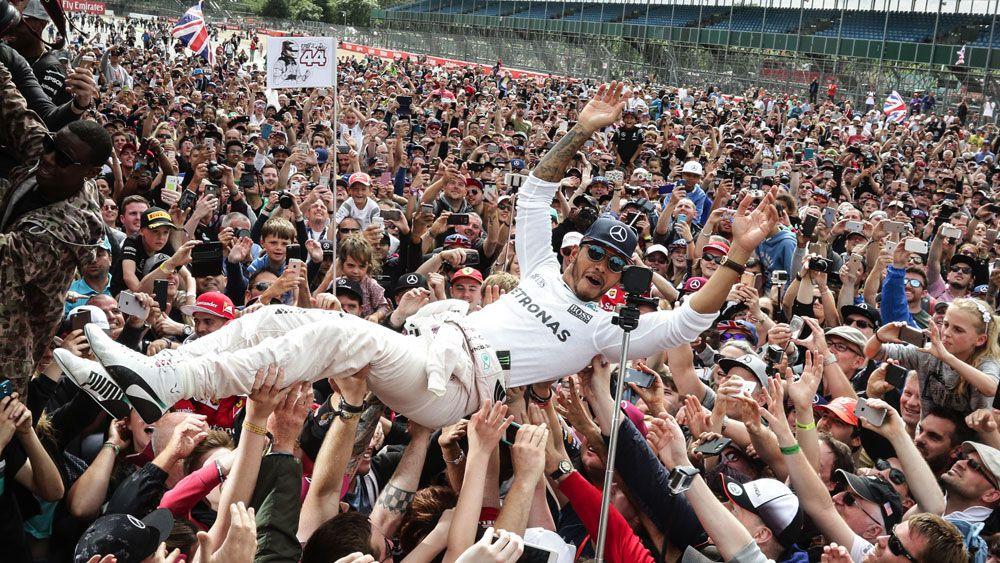 Hamilton delights fans, Rosberg penalised