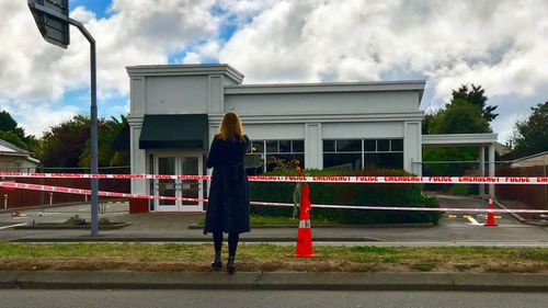 'There were times before a live cross or after when I broke down in tears'. Sophie Walsh stands behind police tape in Christchurch.