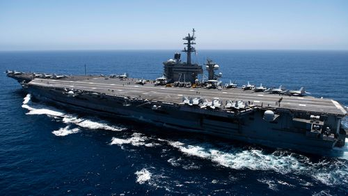 The aircraft carrier USS Theodore Roosevelt transits the Pacific Ocean in 2019. Theodore Roosevelt is conducting operations in the South China Sea.