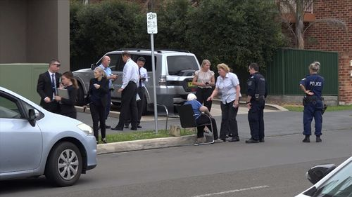 Police speak to an elderly woman who was victim to a car-jacking in Sydney's south yesterday.