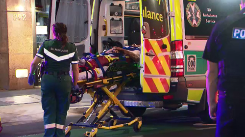 Police cautioned the group for trespassing and a 20-year-old man was taken to Royal Adelaide Hospital fro treatment after falling from the roof.