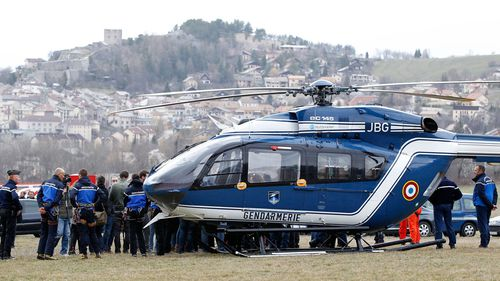Members of the French Gendarmerie gather close to a helicopter in Seyne les Alpes near the crash site. (AAP)