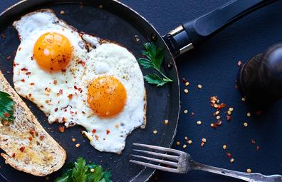 Breakfast of fried eggs in a flying pan