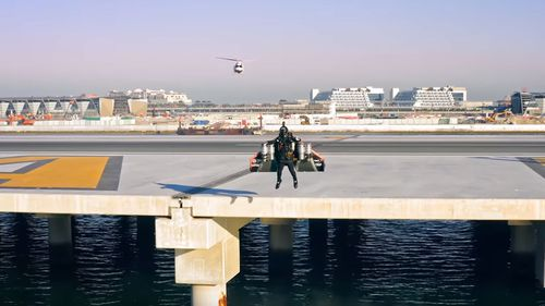 The jetpack pilot took off from a standing start over a pier in Dubai.