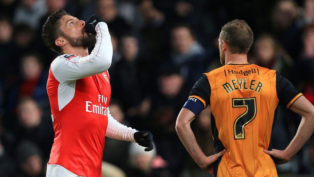 Football: Arsenal ease into FA Cup quarter-finals