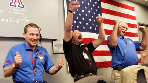 NASA staff celebrate the successful Phoenix landing on Mars in 2008
