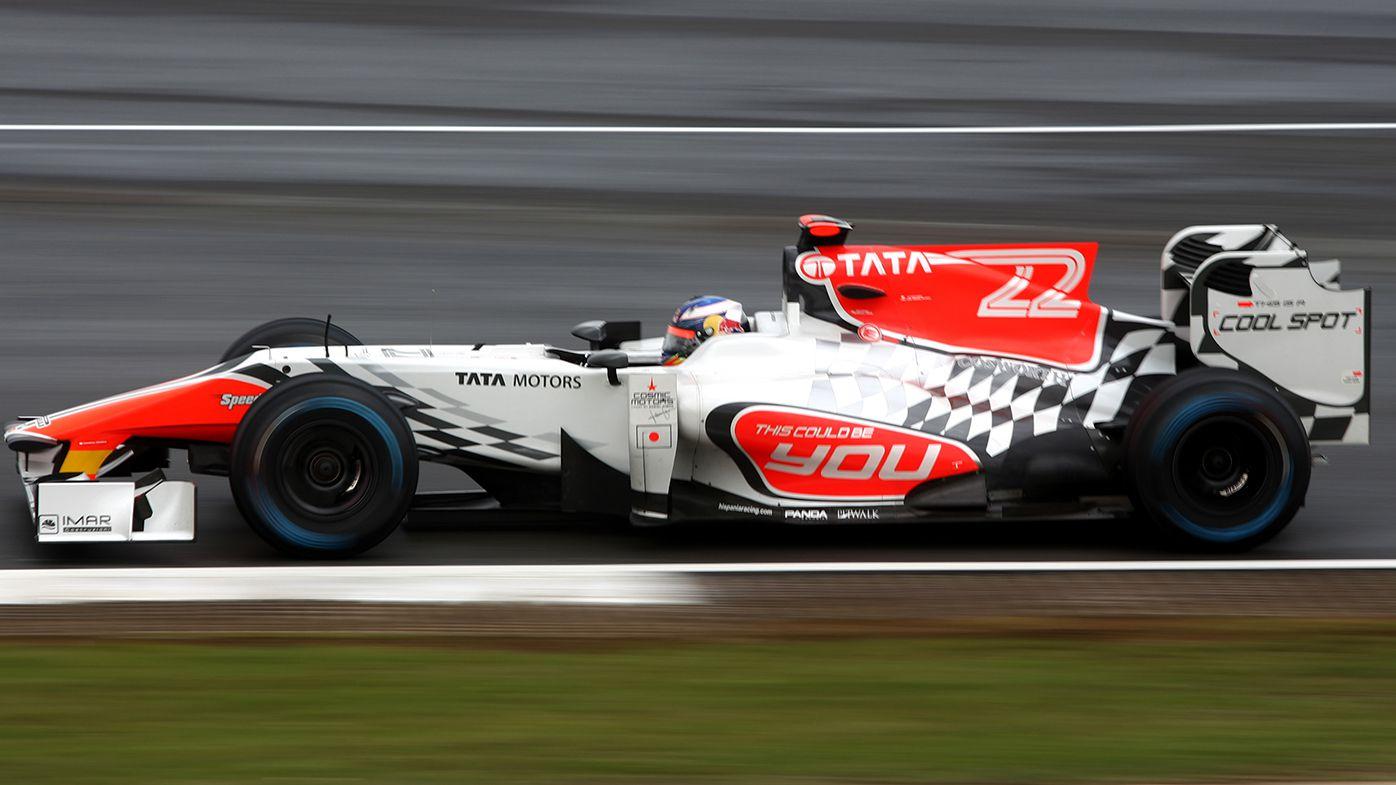 Daniel Ricciardo in action for HRT at the 2011 British Grand Prix.