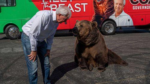 John Cox campaigning along a Kodiak bear.