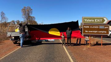 Locals created a blockade at the entrance to Uluru-Kata Tjuta National Park today.