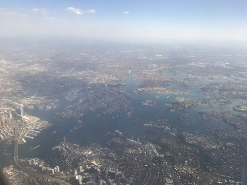 A haze over Sydney was photographed from the air today. (Picture: Emily Wheeler)