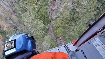 Members of the US Coast Guard aircrew hoisted Mr Oldendorf from the mountain.