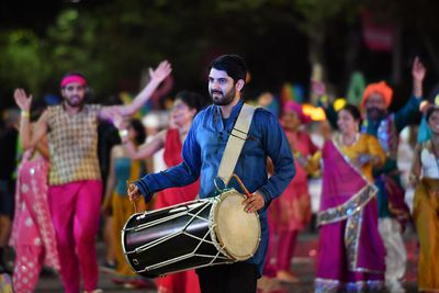 A drum player leads a group of dancers. (AAP)