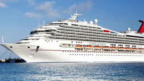 A cabin steward from the Carnival Glory spotted the crew member in the water at around 1.20pm on Sunday.