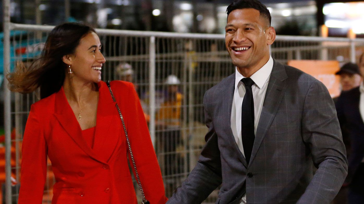 Maria Folau holds hands with husband Israel Folau
