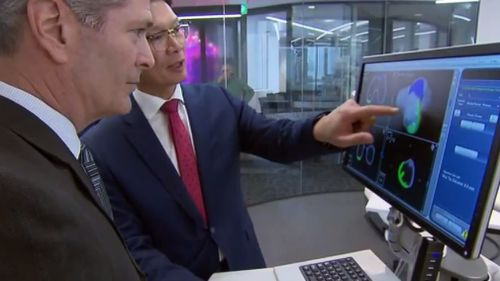 Stryker spokesman Rob Wood and Professor Peter Choong from St Vincent's Hospital. (9NEWS)