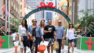 Shoppers are seen during the Christmas trade period on George Street in Sydney's CBD.