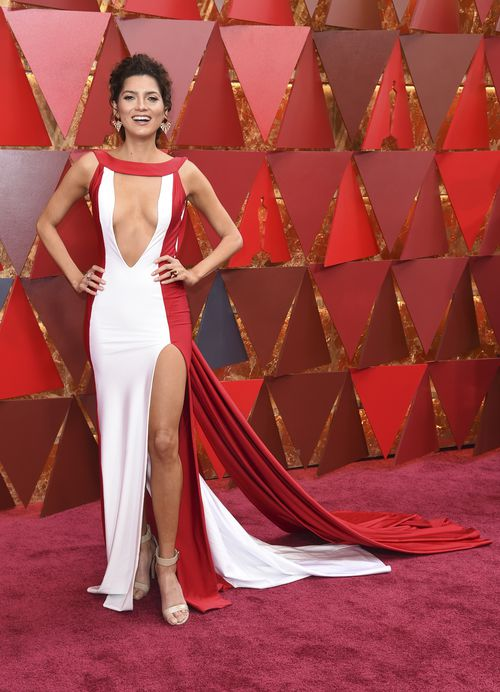 Blanco is wearing a red-and-white satin gown with a generous keyhole front and a high-cut split up her thigh today. (AAP)