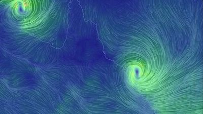 "An Earth wind map showing Cyclones Lam and Marcia bearing down on the Northern Territory and Queensland respectively. (a href=""http://earth.nullschool.net/"")earth.nullschool.net"