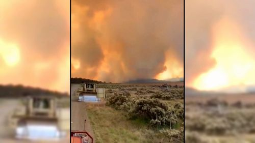 The blaze has sparked emergency warnings, urging those nearby to get out now.
