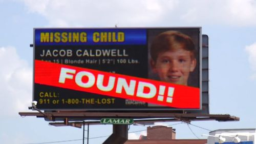 Another billboard breaks the happy news that Jacob had been found living in the basement of a home where people who knew his mother lived.