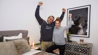The couple were cheering after taking home the first win of the season.