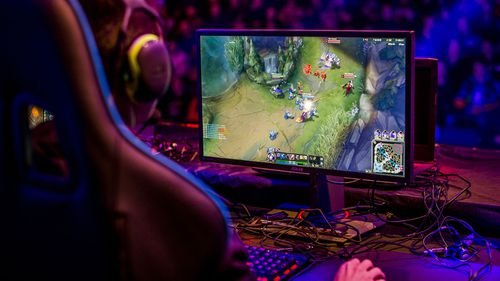 A professional gamer playing League of Legends computer game.