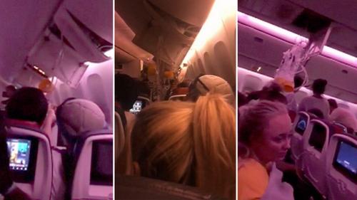 Members of the Newcastle band Hurricane Fall filmed the chaos on board the plane.