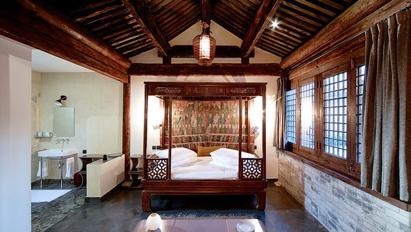 Bedroom and bathroom in the Temple Hotel (Facebook)