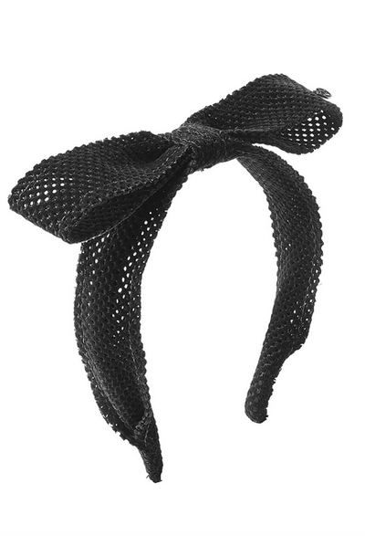 "<a href=""http://www.stylebop.com/au/product_details.php?id=713152"" target=""_blank"">Maison Michel headband with bow, $274. </a><br />"
