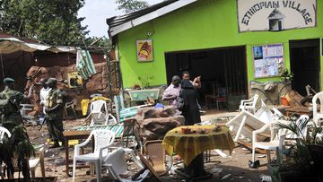The blasts killed dozens. (AAP)