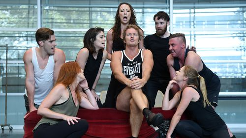 Craig McLachlan (centre), playing the role of Frank N Furter, takes part in a rehearsal with the rest of the cast of the Rocky Horror Show in Sydney on Tuesday, March 31, 2015. (AAP)