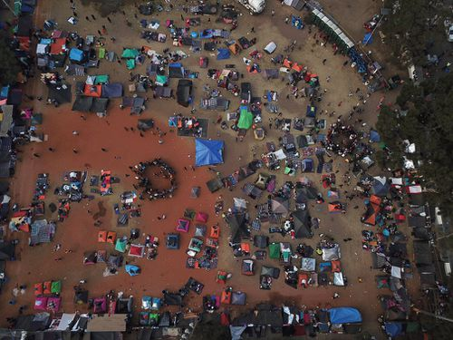 Central American migrants gather in an area designated for them to set up their tents in Tijuana, Mexico.