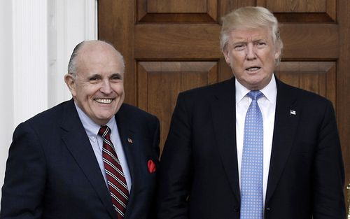 Former New York City Mayor Rudy Giuliani poses with US President Donald J. Trump at the clubhouse of Trump International Golf Club, in Bedminster Township, New Jersey
