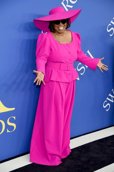 """The CFDA Awards are where designers, stylists, models and muses are honoured by the Council of Fashion Designers of America, but actress and comedian Whoopi Goldberg has taken out the top prize on the red carpet.<br /> <br /> In a head-to-toe fuchsia suit and matching hat by designer and diversity advocate, Christian Siriano, the 62-year-old co-host of <em>The View</em> demonstrated why she may be the fashion world&rsquo;s most underrated icon. The look was powerful, playful and had attitude in spades, much like its wearer.<br /> <br /> But the cherry on top? A pair of black sneakers hidden underneath the suit that ensured the Sister Act star could glide up and down the red carpet with much more ease than her fellow attendees in Manolos and Louboutins.<br /> <br /> This year&rsquo;s CFDA Awards saw supermodel Naomi Campbell take out the Fashion Icon Award, while<a href=""""http://https://style.nine.com.au/2018/06/04/14/34/kim-kardashian-cfda-award-style-evolution"""" target=""""_blank""""> Kim Kardashian West is set to receive theinaugural Fashion Influencer honour.</a><br /> <br /> Also gracing the podium tonight is iconic designer Carolina Herrera who will receive the Founder&rsquo;s Award, and <em>British Vogue</em>&rsquo;s editor-in-chief, Edward Enniful, who will receive the Media Award.<br /> <br /> The CFDA Awards may be slightly more low-key than the Met Gala, but guests such as Cate Blanchett, Ashley Graham and Gigi Hadid deliver a serious high fashion fix.<br /> <br /> Click through to see all the best looks from the 2018 CFDA Awards."""