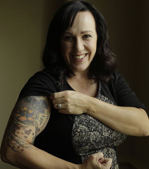 Army helicopter pilot MJ Hegar got a tattoo to cover her shrapnel wounds. Now she's running for Congress in Texas.