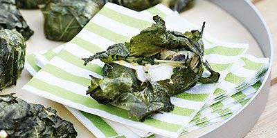 Camembert in vine leaves with parsley almond pesto