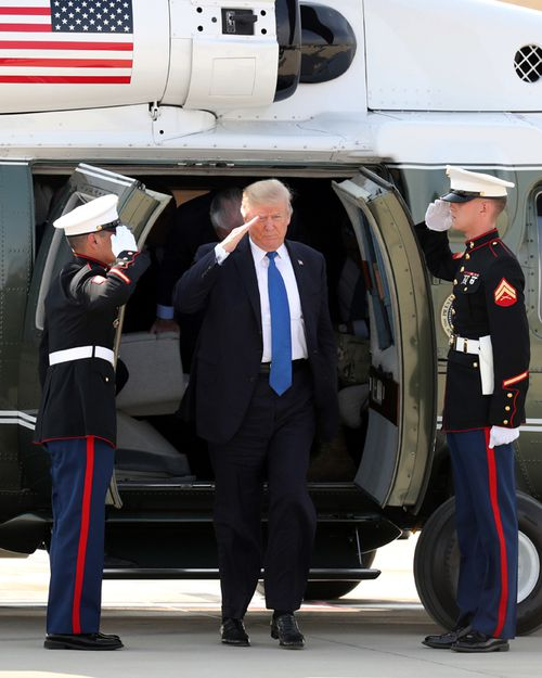US President Donald Trump alights from a helicopter after arriving at Camp Humphreys in Pyeongtaek, south of Seoul.