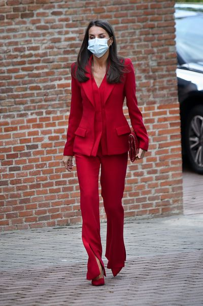 Queen Letizia turns head in red power suit